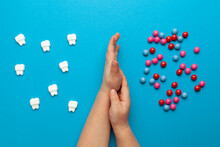 Protecting Children's Teeth From Caries. The Harm Of Sweet Candies For Enamel.