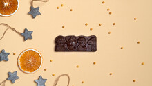 Orange Slices, Wooden Stars And Cake Sprinkles. Chocolate Bar 2021. Top View.