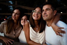 Happy Family Looking Away While Spending Leisure Time During Vacation