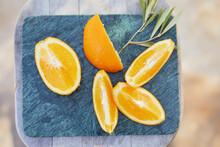 Slice Of Fresh Oranges On Marble Tray