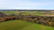 View From Above On The Autumnally Leafy Leaves And Meadows Of The Flood Plains Near Hiltenfingen