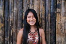 Happy Young Guarani Woman Against Bamboo Wall, Misahualli,  Ecuador