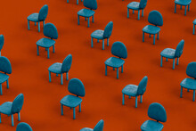Rows Of Blue Empty Chairs On Red Background
