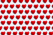 Pattern Of Red Hearts Against White Background