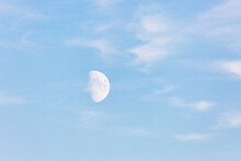 Germany, Brandenburg, Linum, Daytime Moon Against Pastel Blue Sky