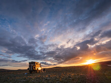 Cloudy Sky OverÔøΩoff-roadÔøΩcar Parked In Remote Icelandic Location At Sunset