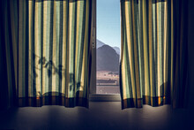 Window Covered By Green Striped Curtains