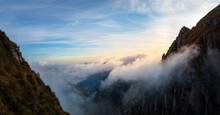 Idyllic Shot Of Mountain Covered By Clouds During Sunrise At Bergamasque Alps, Italy