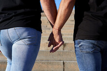 Gay Couple Holding Hands While Standing On Steps