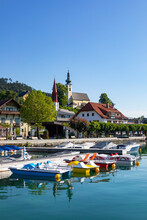 Austria, Upper Austria, Attersee Am Attersee, Pedal Boats Moored In Marina Of Lakeshore Village In Summer