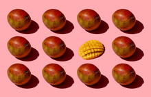 Whole And One Chopped Mango Pattern On Pink Background