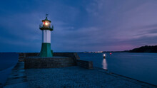 Germany, Mecklenburg-Western Pomerania, Sassnitz, Small Lighthouse On Shore Of Rugen Island At Night