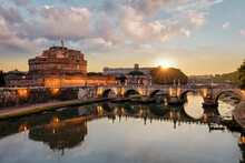 Ponte Sant'Angelo And Castel Sant'Angelo With Tiber River In The Foreground, Rome, Lazio, Italy