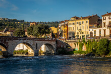 Italy, Veneto, Verona, Arch Bridge Over Adige River With City Houses In Background