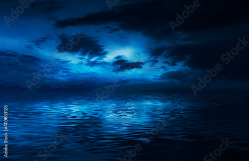 Obraz Night sky, horizon at sunset, moonlight, clouds, waves reflected in water. Empty sea landscape, natural scene. Night view. - fototapety do salonu