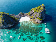 Thailand, Mu Ko Lanta National Park, Yachts Anchored Near Rocks In Sea, Aerial View