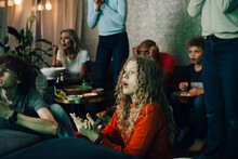Disappointed Family Watching Sports On TV At Night