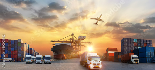 Container truck in ship port for business Logistics and transportation of Contai Fototapet