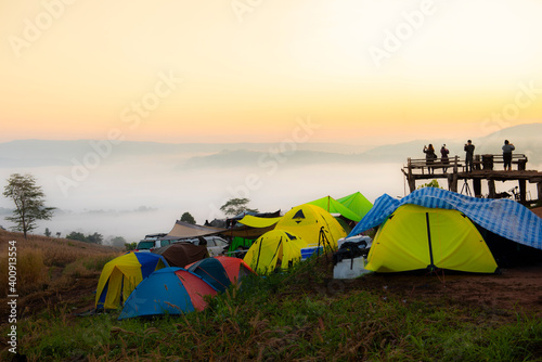 Canvas Camping tent area on mountain, tourist tent camping with fog mist landscape sunrise beautiful in winter view outdoor travel