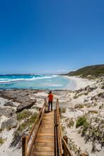 Man In An Orange Jacket Exploring The Esperance Coastline In Western Australia.