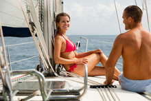 Happy Young Woman Enjoying Hot Summer Day With Husband During Romantic Sea Travel On Pleasure Sailboat
