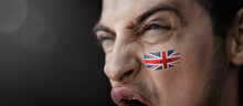 A Screaming Man With The Image Of The United Kingdom National Flag On His Face
