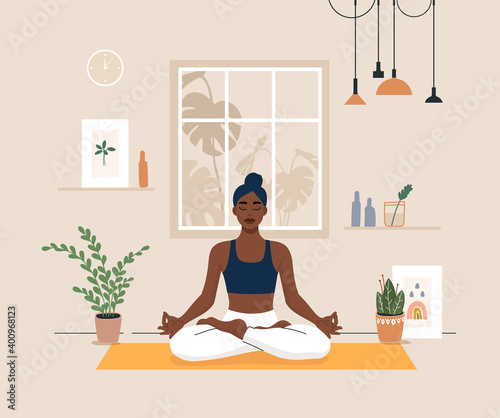 Obraz Young woman doing yoga exercises, practicing meditation on lotus pose on the mat. Black female character practicing in yoga studio or home. Trendy flat vector illustration. - fototapety do salonu