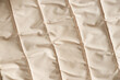 canvas print picture - winter puffy white down jacket close up as background