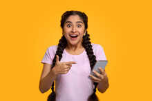 Excited Indian Woman Using Mobile Phone, Celebrating Online Win
