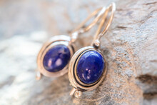 Pair Of Sterling Silver Lapis Lazuli Mineral Earrings On Natural Background