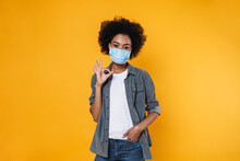 Pleased African American Girl In Face Mask Gesturing Ok Sign