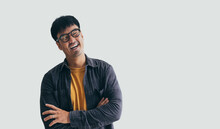 Asian Man Portrait Young Male Wear Eye Glasses Smiling Cheerful Look Thinking Position Happy With Perfect Clean Skin Posing On Isolated White Background.fashion People Life Style Concept