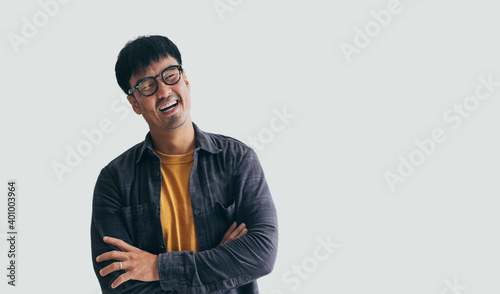 Obraz asian man portrait young male wear eye glasses smiling cheerful look thinking position happy with perfect clean skin posing on isolated white background.fashion people life style concept - fototapety do salonu