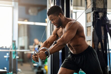 Young Black Athlete Training Triceps On Block Exerciser In Gym