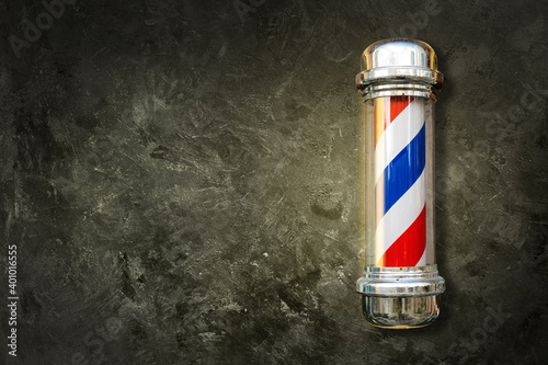 Barber pole. Barbershop pole on a textured background with copy space. - fototapety na wymiar