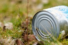 Photo Of Tin Can On Dry Grass