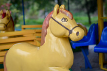Close Up Of The Carousel Horse On The Playground. Selective Focus.