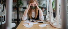 Frustrated Manager Sitting At Table In Closed Cafe, Small Business Lockdown Due To Coronavirus.