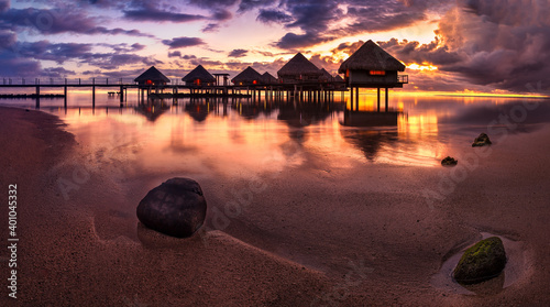 Canvas Print Tahiti bungalows with sunset near beach