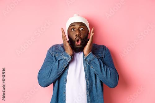 Billede på lærred Shocked and impressed Black man staring at camera with complete disbelief, sayin