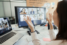Businesswoman Video Conferencing With Coworkers At Computer Screen