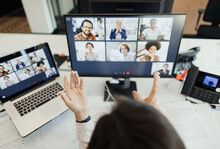 Businesswoman Video Conferencing With Colleagues At Computer Screen