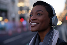Close Up Portrait Happy Young Woman In Headphones On City Street