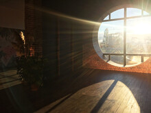 Empty Room With A Large Round Window And Sun Glare