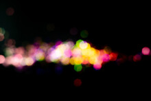 Christmas Colorful Light Black Overlay Background. Defocused Violet And Pink Bokeh. Holiday Garland Decor