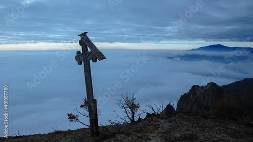 Fotografering A wooden christian crucifix built on the rocky peaks of Cozia Mountains
