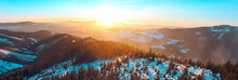 Panoramatic View On Eagle And Jesenik Mountains From Kralicky Sneznik Summit In Winter At Sunset. Snow Is Lying On Hills With A Lot Of Trees.