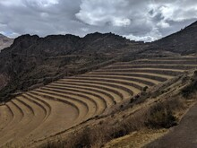 Ancient Curved Terraces Under Cloudy Sky