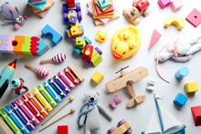 Different Toys On Light Background, Flat Lay