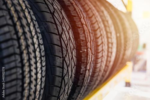 Car tires on shelf in garage shop for sale various type of tyre. Fotobehang
